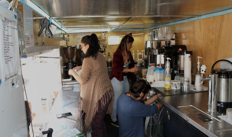Working in a food truck means Pour Jo staff get used to moving around each other.